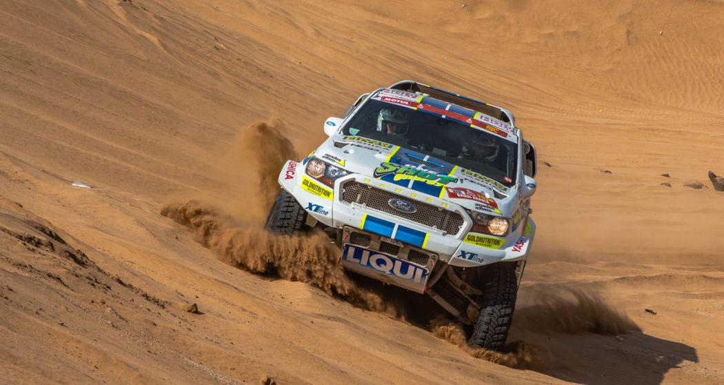 Jedenáctá etapa Rallye Dakar: Stíhací jízda zezadu, lehké zapadnutí v dunách a vyhlížení dakarského cíle